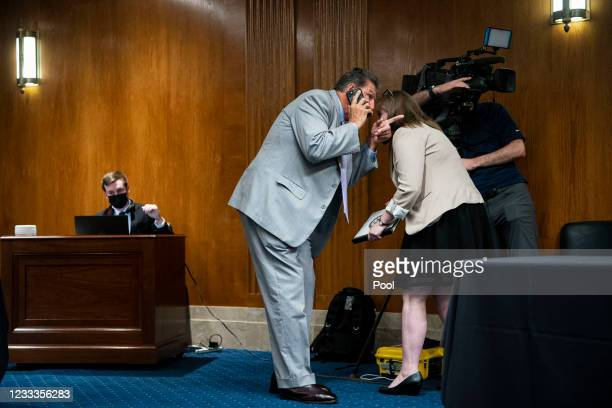 Senator Joe Manchin talks with an aide before a Senate Appropriations Subcommittee hearing on June 9, 2021 at the U.S. Capitol in Washington, D.C....