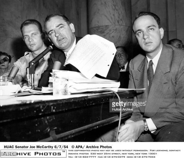 Senator Joe McCarthy is seen here waving a transcript of a monitored call between Pvt. G. David Schine and Army Secretary Stevens, during the...