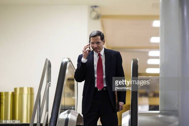 Senator John Barrasso a Republican from Wyoming speaks on a mobile device while on a escalator in the Senate basement of the US Capitol in Washington...