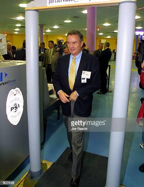 Senator John Breaux walks through a metal detector January 9 2002 during the US Senate Commerce Committee's Surface Transportation and Merchant...