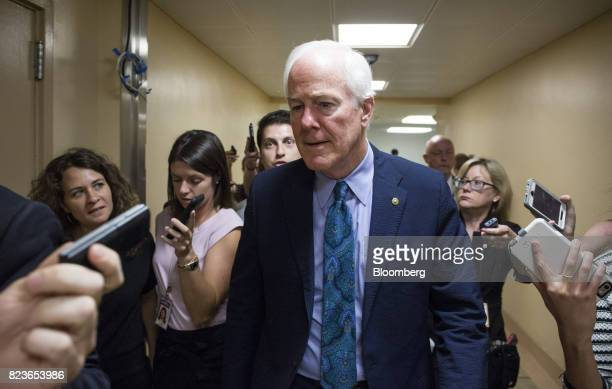 Senator John Cornyn a Republican from Texas center speaks to members of the media near the Senate Subway in Washington DC US on Thursday July 27 2017...