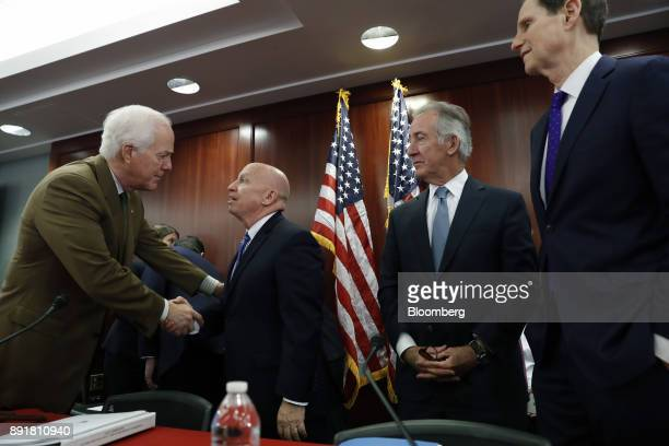 Senator John Cornyn a Republican from Texas left shakes hands with Representative Kevin Brady a Republican from Texas and chairman of the House Ways...
