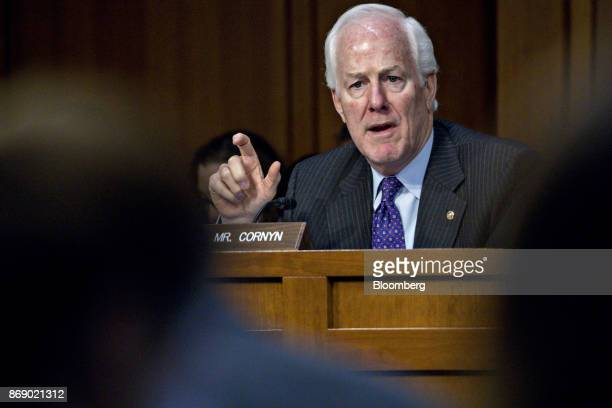 Senator John Cornyn a Republican from Texas questions witnesses during a Senate Intelligence Committee hearing on social media influence in the 2016...