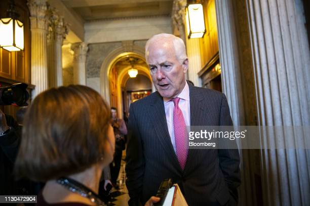 Senator John Cornyn a Republican from Texas speaks to members of the media following a vote on the national emergency declaration in Washington DC US...