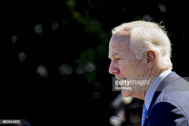 Senator John Cornyn a Republican from Texas speaks to members of the media after a Senate Finance Committee meeting with US President Donald Trump in...