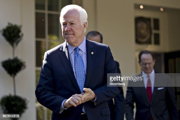 Senator John Cornyn a Republican from Texas walks out of the White House to speak to the media after a Senate Finance Committee meeting with US...