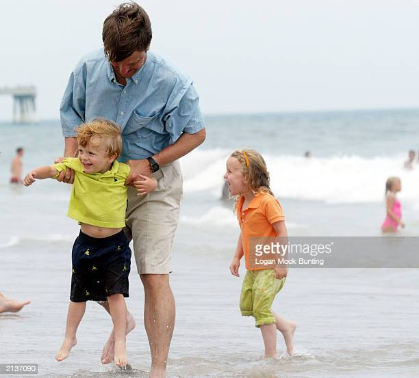 Senator John Edwards plays with his son Jack and daughter Emaa Claire during his Fifth Annual Beach Walk July 4 2003 at Wrightsville Beach NC As...
