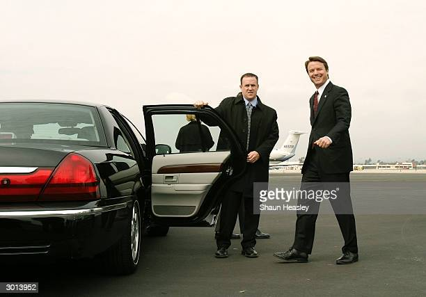 Senator John Edwards walks to his car after arriving at Ontario International Airport aboard a chartered 737 aircraft February 25, 2004 in Ontario,...