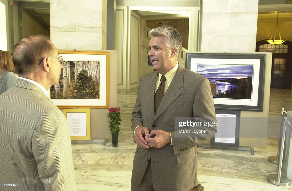 Senator John Ensign, R-Nev., right, speaks with Professor Charles R. Goldman a limnologist from UC-Davis, about the deterioration of Lake Tahoe. The 'Hearts of Light' exhibit is a combination of photography and poetry designed to increase awareness of the Tahoe area.