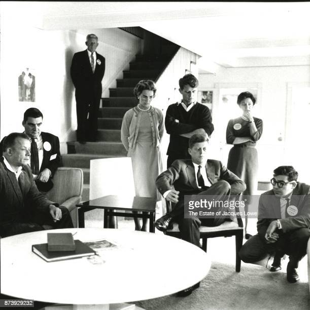 Senator John F Kennedy and family members friends and aides watch returns in the 1960 Presidential Election on television Hyannis Port Massachusetts...