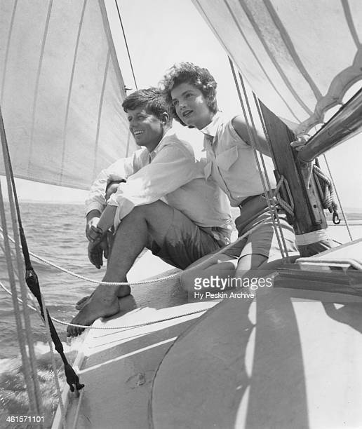 Senator John F Kennedy and fiance Jacqueline Bouvier go sailing while on vacation at the Kennedy compound in June 1953 in Hyannis Port Massachusetts