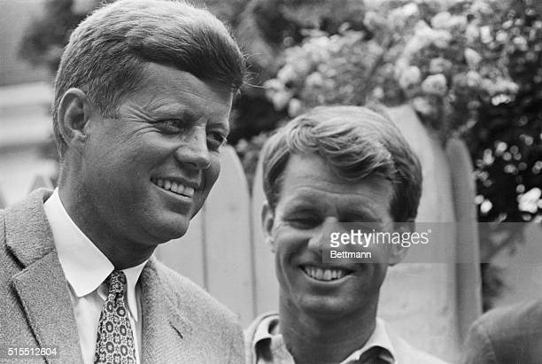 Senator John F. Kennedy, front running candidate for the Democratic Presidential nomination, stands with his brother and campaign manager Robert...