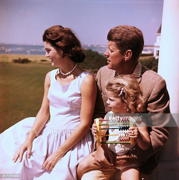 Senator John F Kennedy relaxes w/ his wife Jacqueline and daughter Caroline