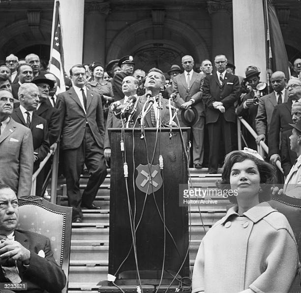 Senator John F Kennedy speaks at a podium during his presidential campaign on the steps of City Hall in New York City. Mayor Lindsay Wagner and...