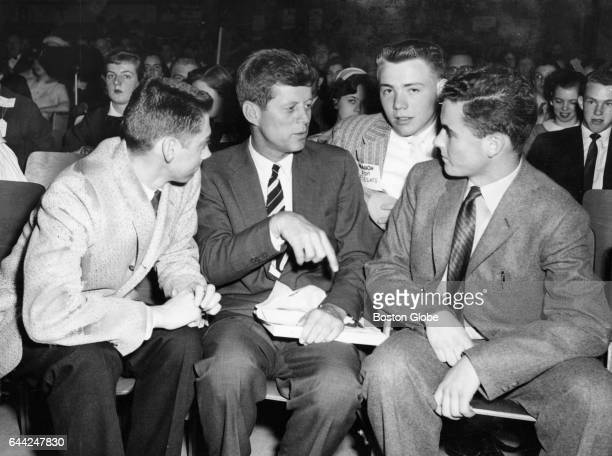 Senator John F Kennedy talks to candidates for office in the Newton Deanery of the CYO at the East Junior High School in Watertown Mass on April 20...