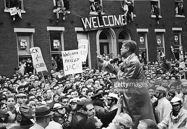 Senator John F Kennedy talks to Temple University students here October 31st including an overflow crowd in the windows of one of the campus...