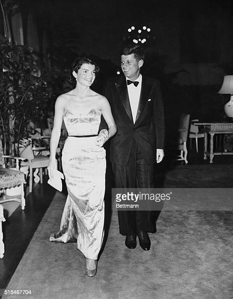 Senator John F Kennedy walking with wife Jackie at the Senate Office Building