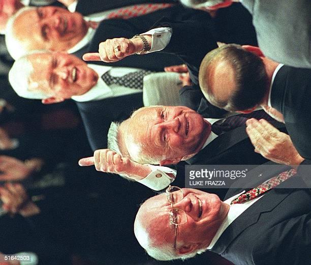 Senator John Glenn DOH is lauded by Senators Patrick Leahy DVT Fritz Hollings DSC and Frank Lautenburg DNJ after being recognized by US President...