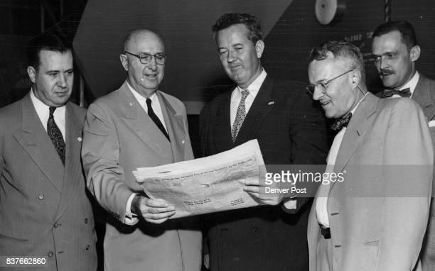 HUDDLE— Senator John J Sparkman Democratic nominee for vice president looks over The Denver Post during a stopover at Stapleton field Wednesday night...