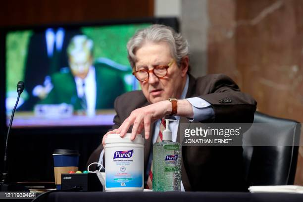 US Senator John Kennedy uses hand sanitizer prior to a Senate Judiciary Committee hearing on the nomination of Judge Justin Walker to be United...
