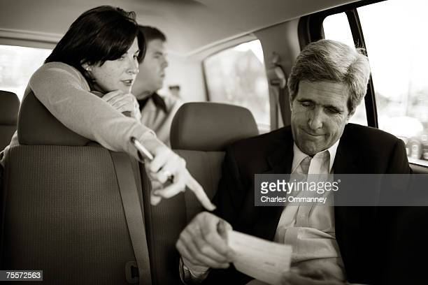 Senator John Kerry and his personal staff travel in a rental car between campaigning October 14 2006 in Auburn and Westbrook Maine