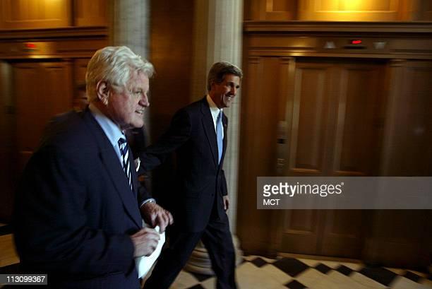 WASHINGTON DC Senator John Kerry and Rep Nancy Pelosi walk between caucus meetings in the Jefferson Building Library of Congress in Washington DC