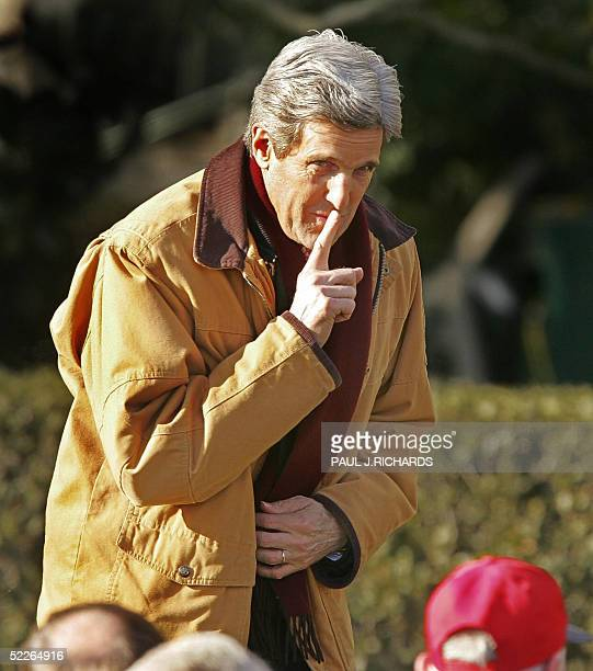 Senator John Kerry DMA rushes in late and as US President George W Bush speaks during a salute to the champions ceremony with the 2004 World Series...