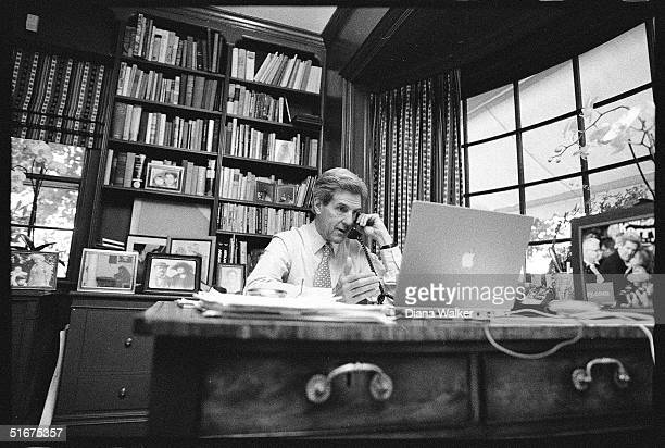 Senator John Kerry in his study at Rosemont Farm, speaks on the phone with Senator John Edwards, offering him the position of running mate on the...
