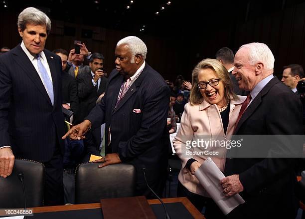 Senator John Kerry is helped to his seat by clerk Bertie Bowman while Hillary Clinton and John McCain enjoy a laugh before the proceedings start John...