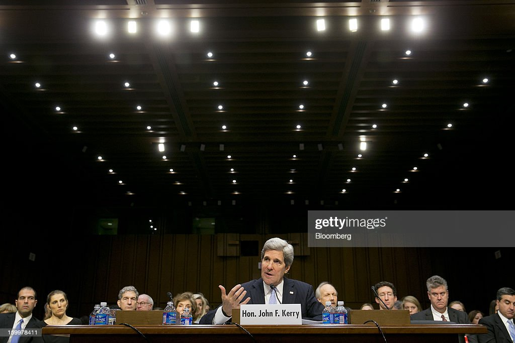 Senator John Kerry, nominee for U.S. Secretary of State and a Democrat from Massachusetts, speaks during a Senate Foreign Relations Committee hearing in Washington, D.C., U.S., on Thursday, Jan. 24, 2013. Kerry stressed the need to prevent Iran from acquiring nuclear weapons. He described the 'immediate, dangerous challenges' facing the nation as he seeks confirmation to become secretary of state. Photographer: Andrew Harrer/Bloomberg via Getty Images