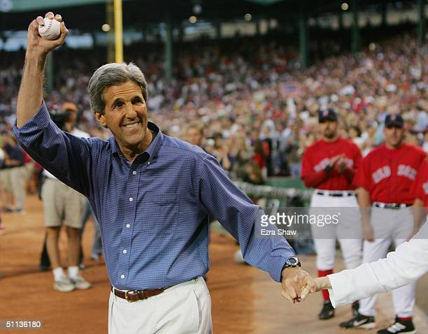 Senator John Kerry of Massachusetts smiles as he prepares to throw the first pitch of the New York Yankees - Boston Red Sox game at Fenway Park on...