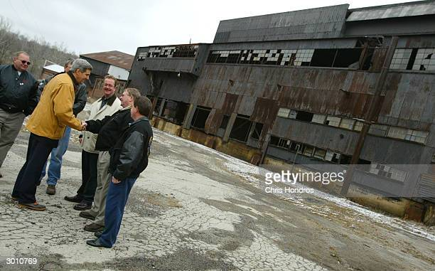 S Senator John Kerry shakes hands with steelworkers outside of the abandoned Youngstown Sheet and Tube Struthers Works factory February 24 2004 in...