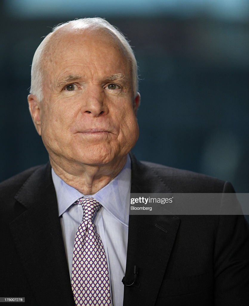 Senator John McCain, a Republican from Arizona, speaks during an interview in Washington D.C., U.S., on Monday, July 29, 2013. Backers of immigration overhaul will use the August recess to try and 'galvanize our broad coalition to make this the highest priority,' McCain said today. Photographer: Julia Schmalz/Bloomberg via Getty Images
