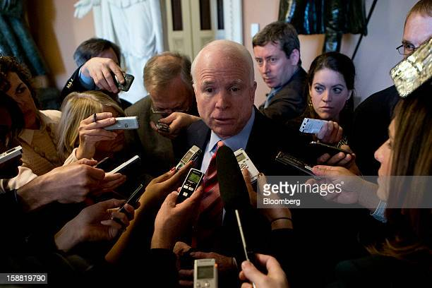 Senator John McCain, a Republican from Arizona, speaks to members of the media about the fiscal crisis negotiations at the U.S. Capitol in...