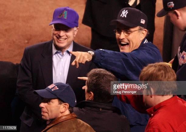 Senator John McCain and New York City mayor Rudolph Giuliani share a light moment before game three of the World Series between the New York Yankees...
