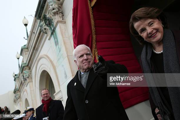 S Senator John McCain and US Sen Dianne Feinstein gesture to US Rep Peter King before the presidential inauguration on the West Front of the US...