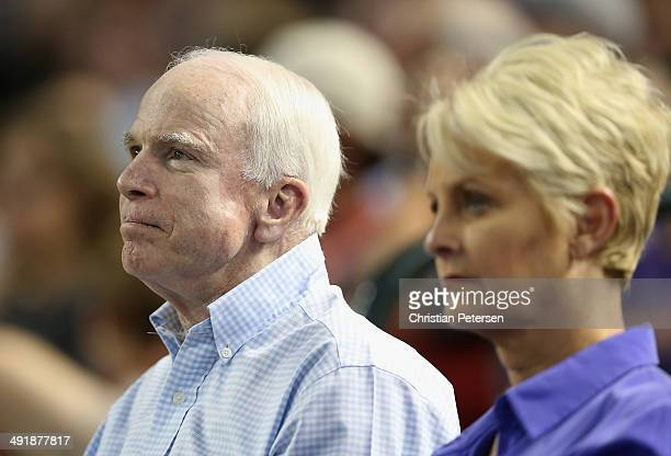 S Senator John McCain and wife Cindy attend the MLB game between the Arizona Diamondbacks and the Los Angeles Dodgers at Chase Field on May 17 2014...