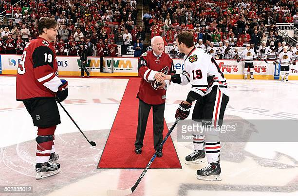 S Senator John McCain is welcomed to the ice by Jonathan Toews of the Chicago Blackhawks and Shane Doan of the Arizona Coyotes before taking part in...