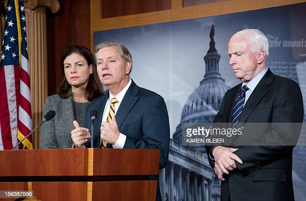 US Senator John McCain Lindsey Graham and Kelly Ayotte during a press conference November 14 2012 on Capitol Hill in Washington DC regarding the...