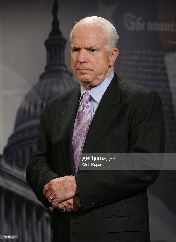 US Senator John McCain (R-AZ) listens during a news briefing June 25, 2009 on Capitol Hill in Washington, DC. McCain has proposed legislation to assist the people of Iran in promoting democracy. He said he would like to increase US-backed radio broadcasts into Iran.