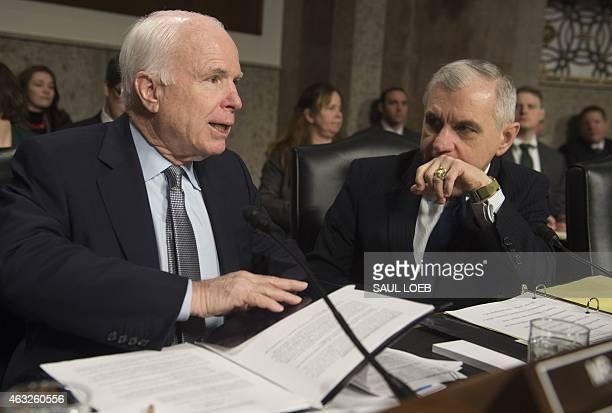 US Senator John McCain Republican of Arizona and committee chairman speaks with US Senator Jack Reed Democrat of Rhode Island and Ranking Member...