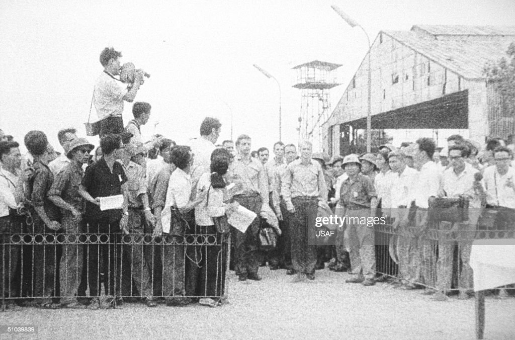 Senator John Mccain, Right, Leads A Column Of Men Released From A P.O.W. Camp March 14, 1973 In Hanoi, North Vietnam. The P.O.W.'s Await Transportation To Gia Lam Airport.