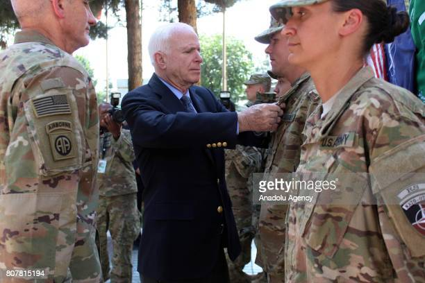 Senator John McCain salute NATO soldiers at ISAF HQ in Kabul Afghanistan on July 4 2017 US Senator John McCain visited the headquarters of NATOled...