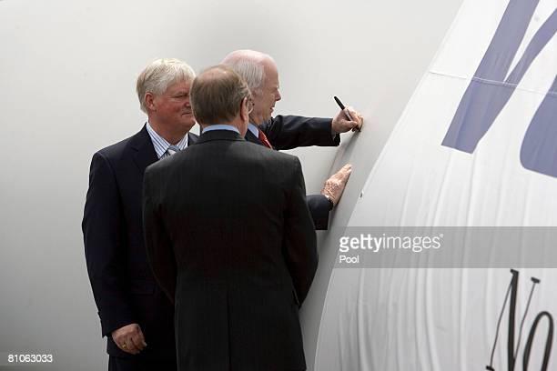 S Senator John McCain signs the blade of a wind turbine at Vestas Wind Energy Training Facility as Vestas America President Jens Soby and Oregon...