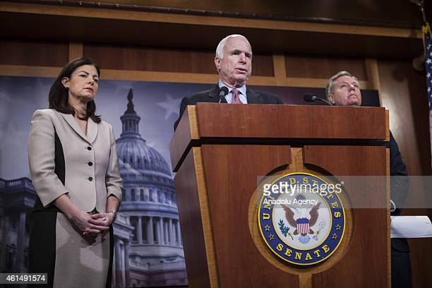 Senator John McCain speaks at a press conference with Senator Kelly Ayotte , Senator Lindsey Graham , and Senator Richard Burr to announce new...