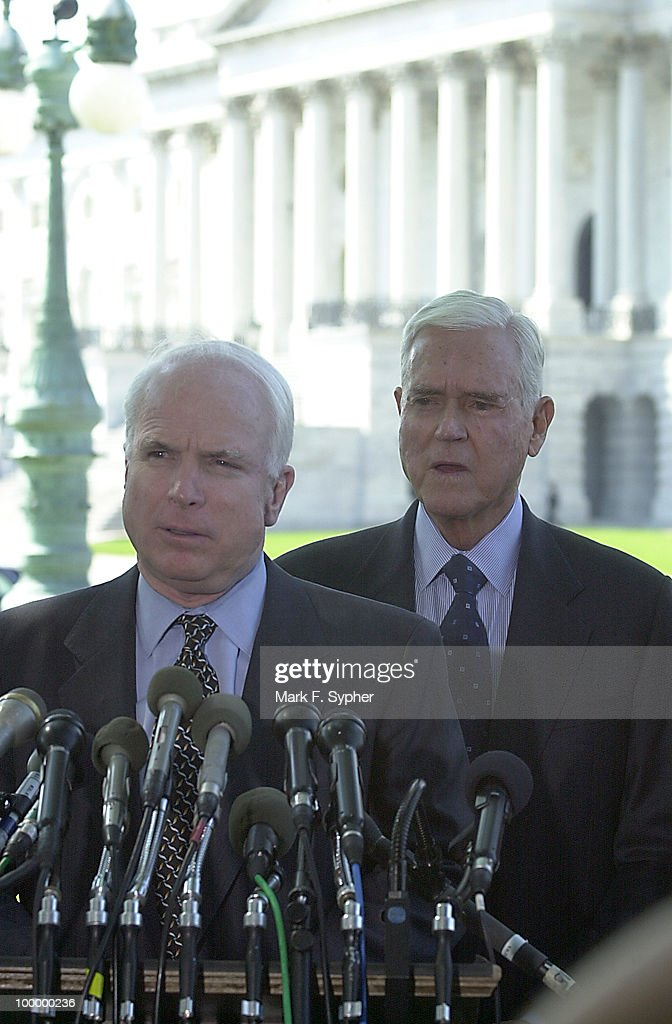 Senator John McCain (R-AZ) spoke at a press conference on Tuesday concerning airline safety while Sen. Ernest F. Hollings (D-SC) waits for his turn at the podium at the Senate Swamp on Tuesday.
