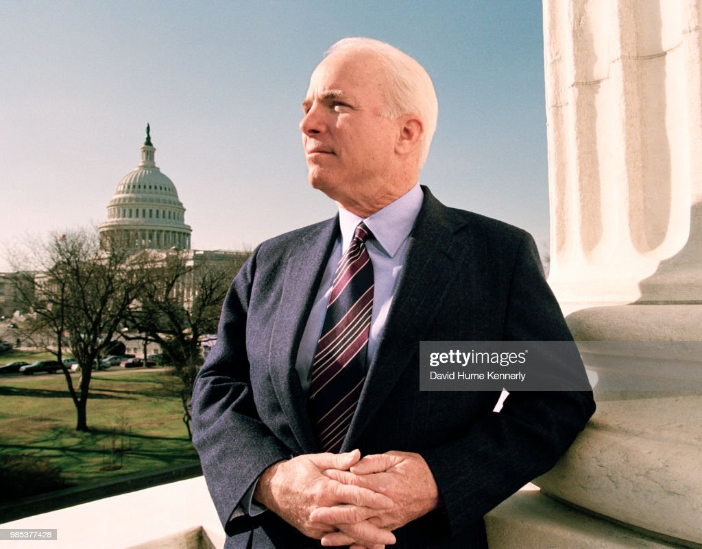 US Senator John McCain stands at the Russell Senate Office Building with the US Capitol in the background, Washington, DC, January 20, 2000.