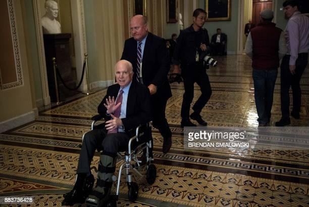 Senator John McCain uses a wheelchair on Capitol Hill December 1 2017 in Washington DC Donald Trump's tax reform plan has overcome pockets of...