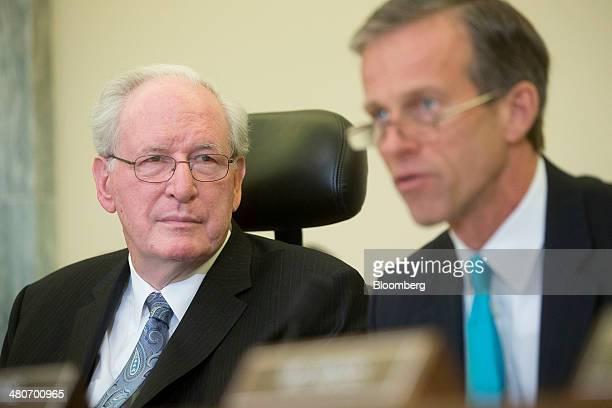 Senator John Rockefeller a Democrat from West Virginia and chairman of the Senate Commerce Committee left looks on as Senator John Thune a Republican...