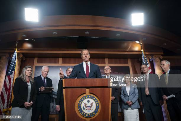 Senator John Thune, a Republican from South Dakota, center, speaks during a news conference at the U.S. Capitol in Washington, D.C., U.S., on...